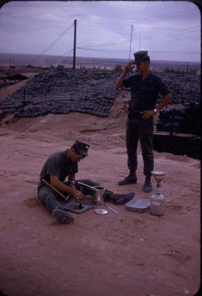 EA3 Tom Hartnett doing a soil compaction test...BU2 Randy Robertson supervising