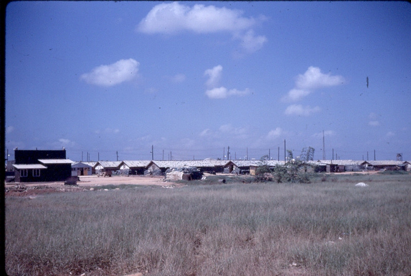 Camp Rhodes-Quang Tri...Outdoor movie screen on the left...late August 1968 we were watching a movie when we heard a 'whooose'...a Viet Cong rocket aiming for the airstrip clipped the corner of the screen and buried in the mud but didn't detonate...a bunch of lucky Seabees that night...we were all awarded Combat Action Ribbons...glad they weren't Purple Hearts