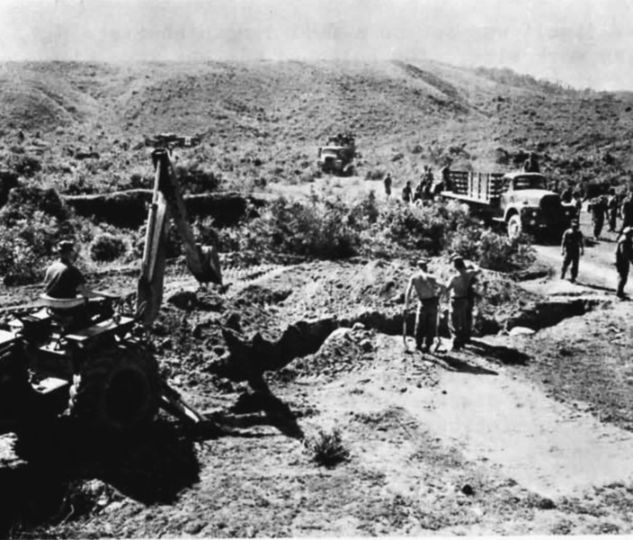 A backhoe was used to expedite construction of fortifications as NMCB-9's Detail Echo strove to consolidate their hold on the Hill 494 quarry site