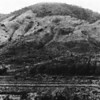 The western slope of Hill 494, proposed virgin site for NMCB-9's development of a major quarry, rock crushing facilities, and cantonment, appeared as shown in December 1967.