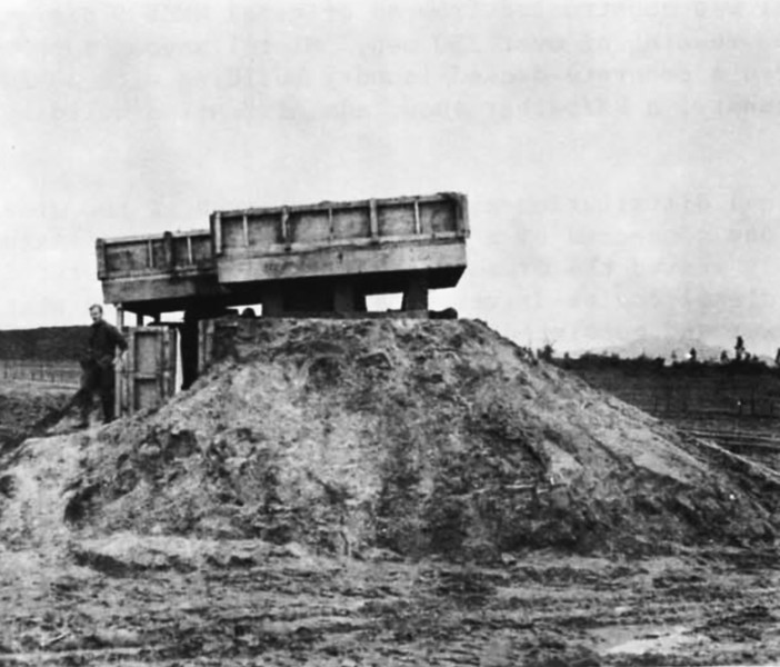 Fifteen line bunkers of sand-filled plywood cavity wall construction were built along the perimeter of the quarry site