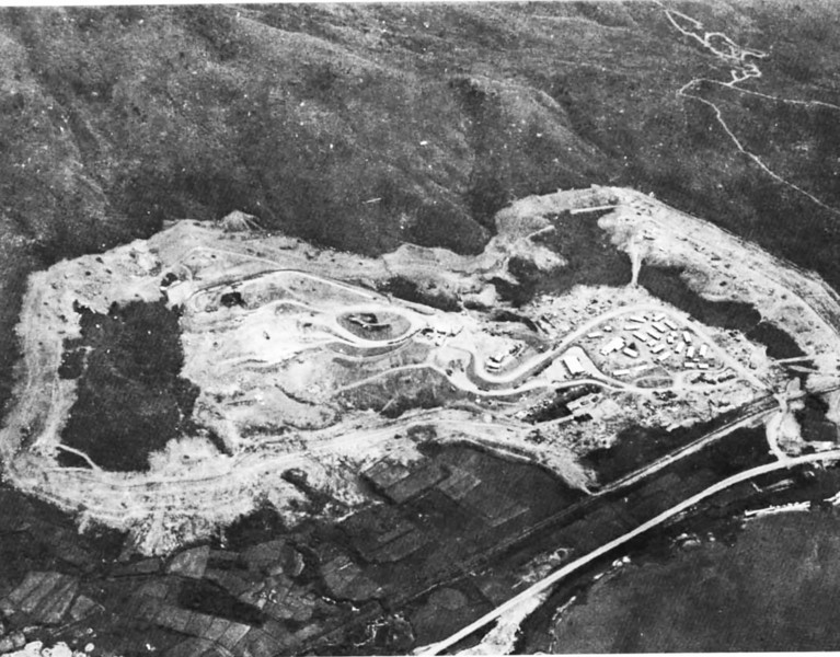 The Camp DeShurley Rock Production Facility shown from the northeast nearing completion in May 1968. Pioneer trails in the upper right hand corner indicate the area in which new quarry faces were to be developed ny NMCB-71