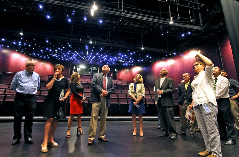First group to tour the new MCC Academic Arts Center looking over the theatre with Chairperson of the Performing Arts Karen Oster on far right speaking to the group. SUN/David H. Brow