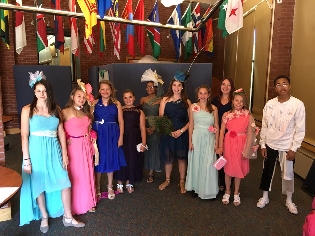 . Young ladies along with apprentice Solomon, far right, show the dresses and exquisite fascinators they redesigned from dresses donated by Chantilly Place.