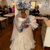 """Lakeisha, the gorgeous """"bride,"""" holds a bouquet of roses hand-made of newspaper and tulle and show off her dramatic headpiece."""