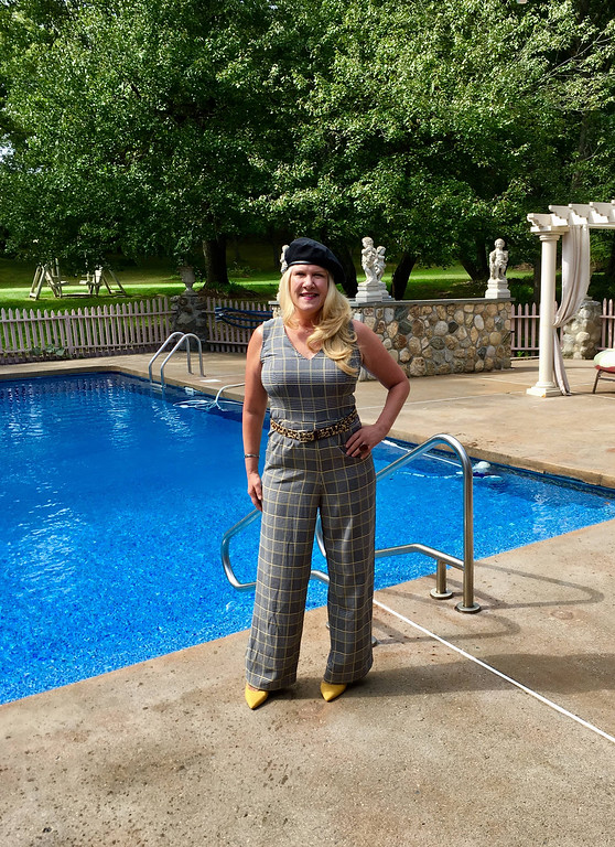 . Plaid is never a fad: Plaid and mixing patterns are huge this fall! Wearing this plaid, sleeveless jumpsuit, I added a leopard belt, and a little zing with a mustard suede pump! Since we were celebrating the arts, I tied in my look with a black beret, which is also making a big comeback!