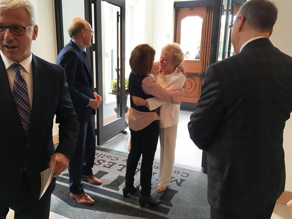 . Guests greet former MCC President Carole Cowan