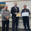January 2016 - Commission chair Ron Holmes (r) accepts the sponsorship funds for the Young Maine Volunteer Roll of Honor from Grand Master David A. Walker (center), Freemasons in Maine. Accompanying Mr. Walker is the state Grand Marshall, William M. Layman (l).