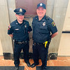 Lowell police Officer Tom Hickey and Bedford police Officer Craig Naylor, who are their respective department's liaison to MCC's two campuses.