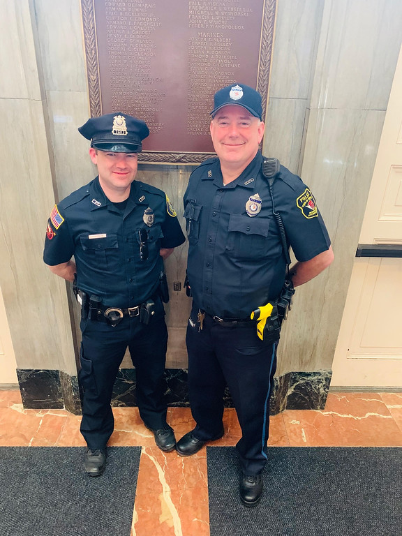 . Lowell police Officer Tom Hickey and Bedford police Officer Craig Naylor, who are their respective department\'s liaison to MCC\'s two campuses.