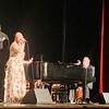 "Voice student Heather Demers of Dracut belts out ""Don't Go Breaking My Heart"" with ""Piano Men"" singer/pianist Joe Boucher as Elton John."
