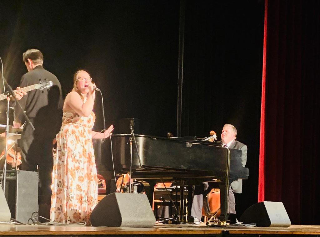 . Voice student Heather Demers of Dracut belts out �Don�t Go Breaking My Heart� with �Piano Men� singer/pianist Joe Boucher as Elton John.