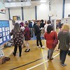 JENN SMITH — THE BERKSHIRE EAGLE <br /> Massachusetts College of Liberal Arts students presented more than 50 posters summarizing their research projects in the Venable Gym at the April 19 Undergraduate Research Conference.