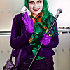MCM Manchester Comic Con 2016, Cosplay, Cosplayer, Female, The Joker, Batman, Mistah J, Pudding, Villain, Psychopath, Master Criminal, Insane, Jacket, Blouse, Corset, Tie, Bow, Skirt, Tartan, Tights, High Heels. Handbag, Gloves, Cane, Walking Cane, Chattering Teeth, Wig, Purple, Green, Orange, White, Red, Black