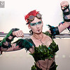 MCM Manchester Comic Con 2016, Cosplayer, Female, Batman, Poison Ivy, Green, Corset, Pants, Shoes, Feathers, Face Paint, Goggles, Arm Guards, Gloves, Shoulder Pads, Red, Vines, Cosplay, Girl Skirt, High Heels, DC Comics, Comics, Leafs, DC, Gun, Chains, Pamela Lillian Isley, Gotham City Sirens, Injustice League, Suicide Squad