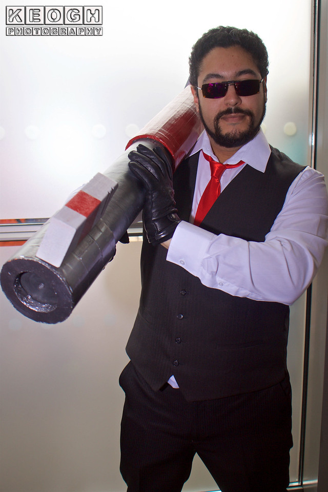 MCM Manchester Comic Con 2016, Cosplay, Cosplayer, Male, Anime, Manga, RWBY, Suit, Shirt, Tie, Waistcoat, Gloves, Pants, Shoes, Glasses, Sun Glasses, Rocket Launcher, Black, Red, Whist, Silver, Leather