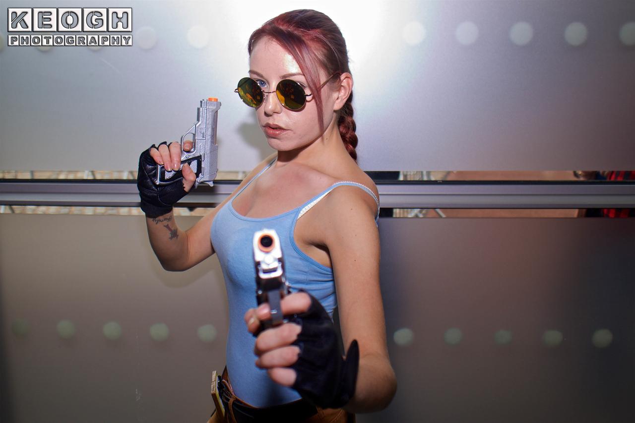 MCM Manchester Comic Con 2016, Cosplay, Cosplayer, Female, Video Games, Comics, Films, Lara Croft, Tomb Raider, Sony Playstation, Xbox, Explorer, Archeologist, Adventurer, Tank Top, Vest, Shorts, Utility Belt, Gun Holster, Boots, Socks, Gloves, Guns, Glasses