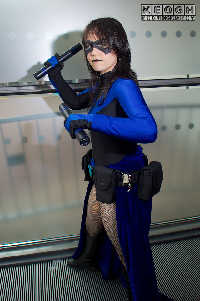 MCM Manchester Comic Con 2016, Cosplay, Cosplayer, Female, DC Comics, Comics, Animated Series, Video Games, Batman, Nightwing, Hero, Jumpsuit, Gloves, Gauntlets, Batons, Mask, Boots, Black, Blue, Dress, Boots