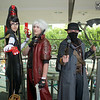 MCM Manchester Comic Con 2016, Cosplay, Cosplayers, Group Shot, Bayonetta, Devil May Cry, Bloodbourne, Witch, Demon Hunter, Cowboy, Black, Red, Brown, Grey, Hat, Mask, Waist Coat, Jumpsuit, High Heels, Guns, Scythe, Glasses, Straps