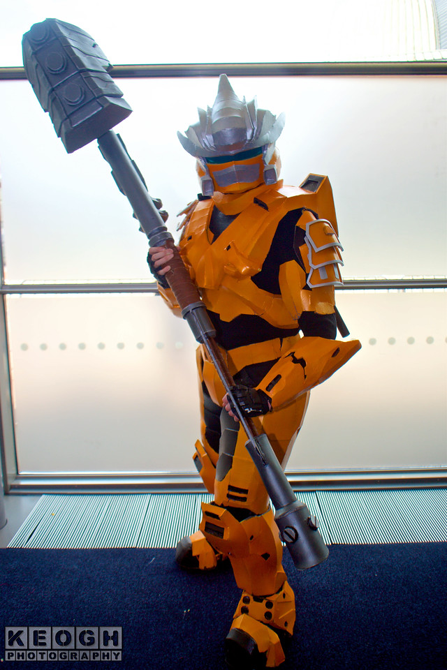 MCM Manchester Comic Con 2016, Cosplay, Cosplayer, Male, Anime, Manga, Comic, Films, Video Game, Fantasy, Sci-Fi, Soilder, Warrior, Weapon, Armour, Metal, Helmet, Orange, Black, Silver