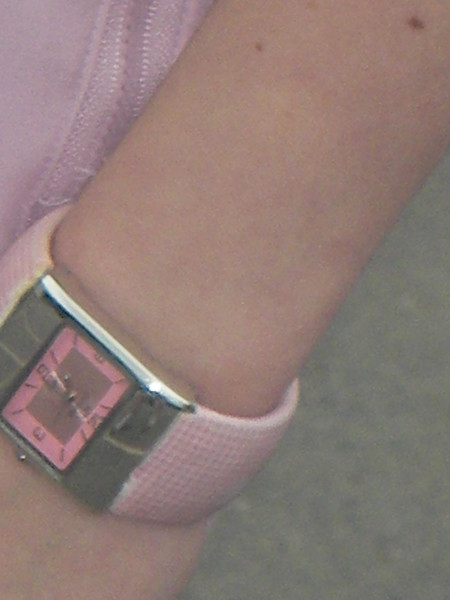 Do you know who owns the pink watch?