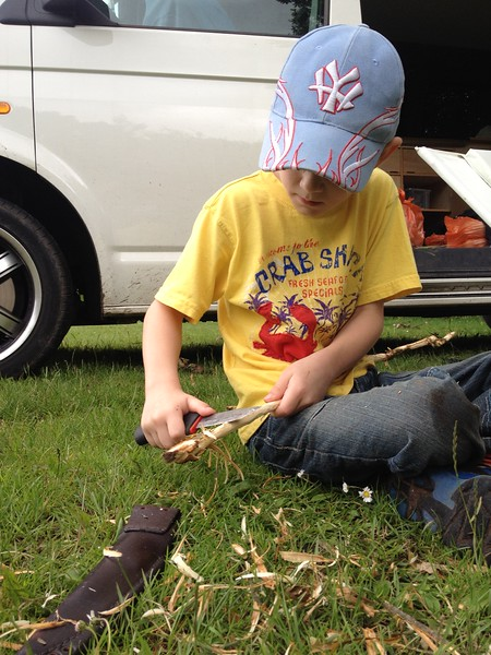 Whittling a stick to toast the marshmallows