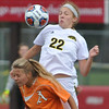 Macomb Lutheran North's Emily Mathews (22) battles for the ball with Almont's Alayna Panduren during the MHSAA D3 Regional semi-final played on Tuesday June 6, 2017 at Troy Athens HS.  The Mustangs defeated the Raiders 7-0.  (MIPrepZone photo by Ken Swart)