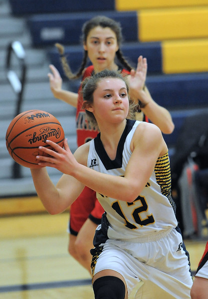 Elise Vitale (12) of Fraser passes the ball during the match between Fraser and Anchor Bay on January 24, 2017. (MIPrepZone photo gallery by David Dalton)