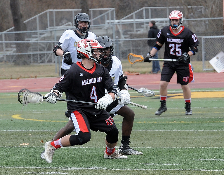 Nick Kessler (4) of Anchor Bay moves the ball down the field during the match beteen Anchor Bay and L'Anse Creuse North on March 27, 2017.  (MIPrepZone photo gallery by David Dalton)