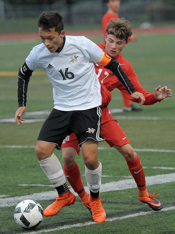 . Dylan Wismont (16) of L�Anse Creuse North battles for control of the ball with Cody Smith (17) of Anchor Bay during the match between Anchor Bay and L�Anse Creuse North on October 11, 2017. THE MACOMB DAILY PHOTO GALLERY BY DAVID DALTON