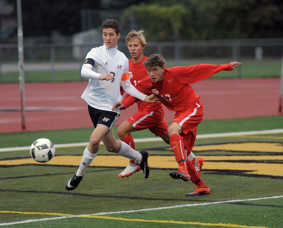 . Reed Duerbusch (13) of L�Anse Creuse North battles for control of the ball with Niko Welchner (11) and Cody Smith (17) of Anchor Bay during the match between Anchor Bay and L�Anse Creuse North on October 11, 2017. THE MACOMB DAILY PHOTO GALLERY BY DAVID DALTON