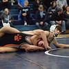 Hunter Seguin of Richmond works toward a pin against Armada's Connor Collins at 125 pounds. Richmond defeated Armada 67-4 in a BWAC dual meet on Jan. 25, 2017. The victory gave the Blue Devils a final record of 7-0 in league matches. (MIPrepZone photo gallery by George Pohly)