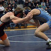 Austin Kilburn, right, of Richmond wrestles Armada's Justin Madill at 112 pounds. Kilburn won by a pin. (MIPrepZone photo gallery by George Pohly)