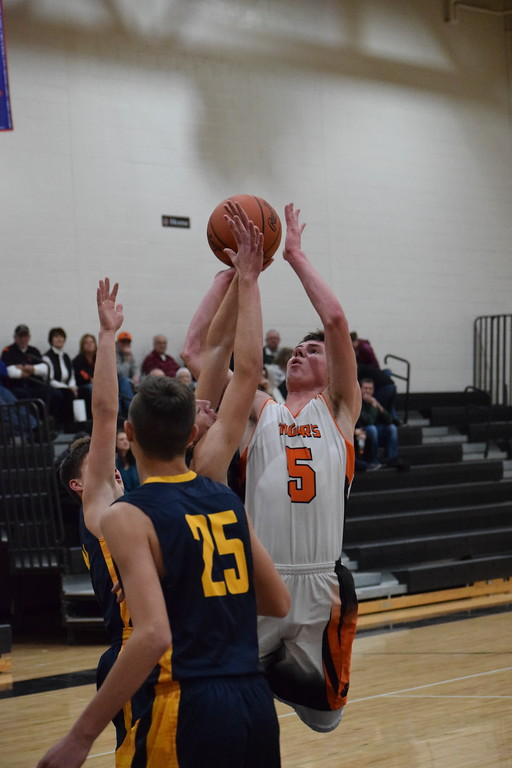 . Armada\'s Adam Job (5) scored 34 points in the Tigers\' 56-42 win over Memphis in a non-conference boys basketball game on December 5, 2017. THE MACOMB DAILY PHOTO GALLERY BY CHUCK PLEINESS