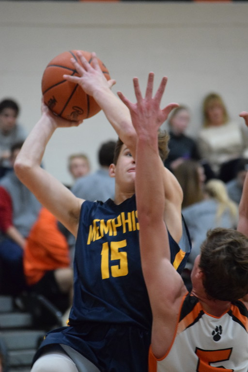 . Memphis\' Steve Serafin (15) puts up a shot over Armada\'s Adam Job (5) in a non-conference boys basketball game on December 5, 2017. THE MACOMB DAILY PHOTO GALLERY BY CHUCK PLEINESS
