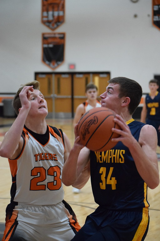 . Memphis\' Dawson Stier (34) looks to put up a shot over Armada\'s Joshua Bowman (23) on December 5, 2017. THE MACOMB DAILY PHOTO GALLERY BY CHUCK PLEINESS