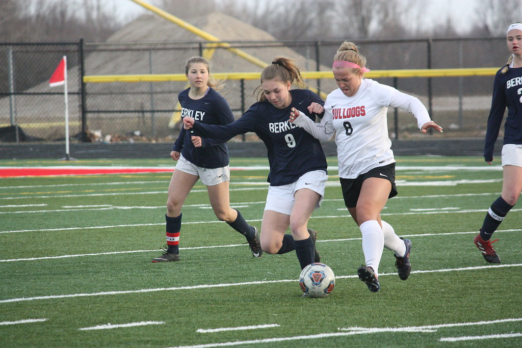 . Romeo\'s Macy Manchester and Berkley\'s Karsen Murray battle for possession of the ball during their non-league match on April 10 at Romeo. (Photo gallery by Kevin Lozon)