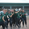 New Haven players celebrate after Kailyn Weier (9) scored on a single by Sydney Glefke (4) in the bottom of the eighth inning to lift the Rockets to a 7-6 victory over Capac in a Division 3 district championship game.