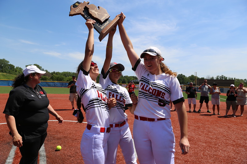 Divine Child players hold up a Division 2 regional championship trophy, the ninth in school history. (Photo by Bill Roose)