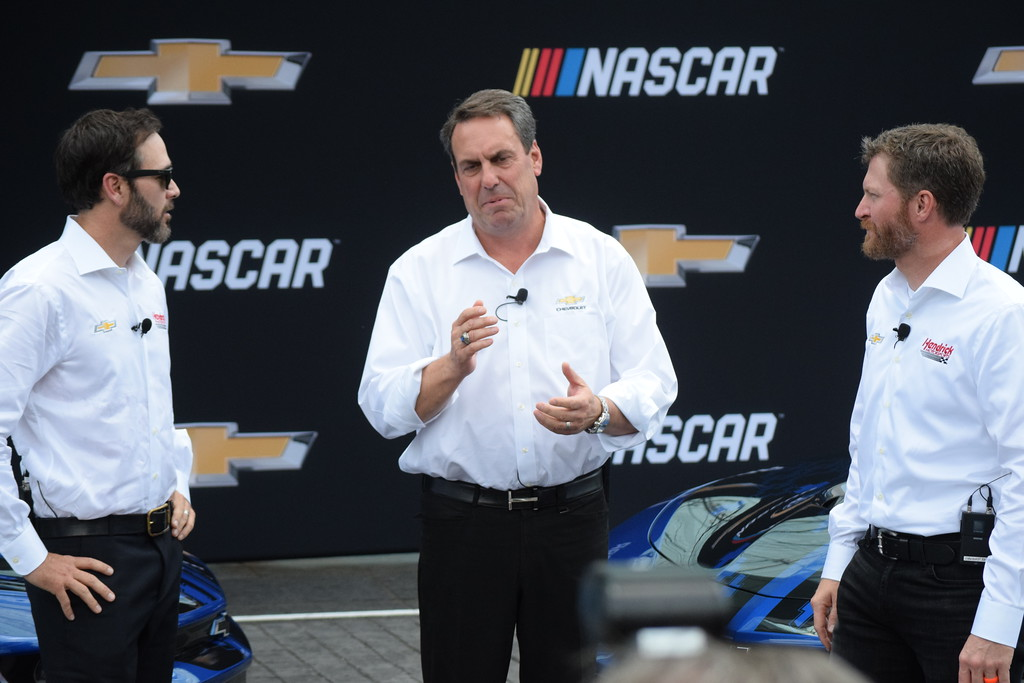 . Chevrolet executive Mark Reuss discusses the Camaro ZL1 race car with NASCAR drivers Jimmie Johnson, left, and Dale Earnhardt Jr.