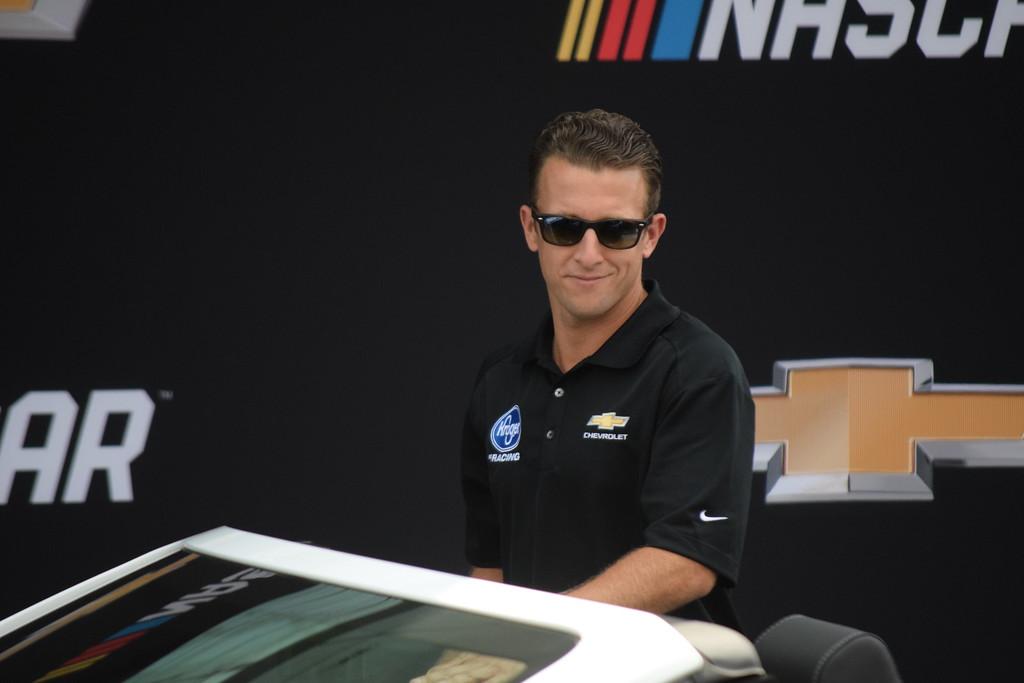 . NASCAR driver AJ Allmendinger arrives at the unveiling of the 2018 Chevrolet NASCAR Cup car.
