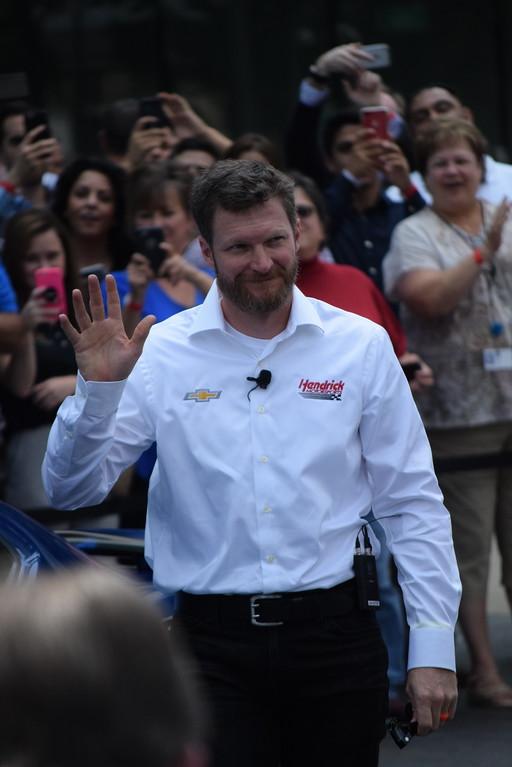 . NASCAR driver Dale Earnhardt Jr. waves as he arrives at GM headquarters.