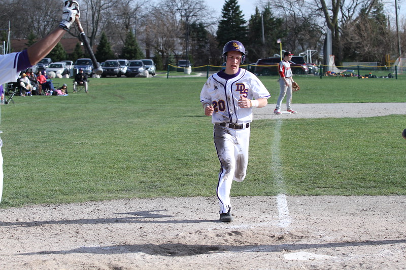 Joe Kraft (20) scores on Jake Badalamenti's third-inning double putting the Pilots on top, 6-5. It was De La Salle's first lead of the game. (Photo by Bill Roose)