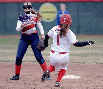 Gina Liss (1) of Chippewa Valley slides in to second after geting a hit during the match between Cousino and Chippewa Valley on April 13, 2018. MACOMB DAILY PHOTO GALLERY BY DAVID DALTON