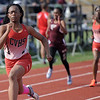 Angelica Floyd of Chippewa Valley crosses the finish line in the 100 meter race on April 18, 2017. (MIPrepZone photo gallery by David Dalton)