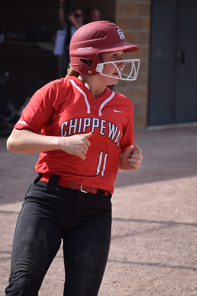 Brook Misch scores one of her three runs to help lead Chippewa Valley over L'Anse Creuse North, 21-10, to keep the Big Reds' MAC White title hopes alive. Misch was 3-for-4 with two doubles and four RBI. (MIPrepZone photo gallery by Chuck Pleiness)