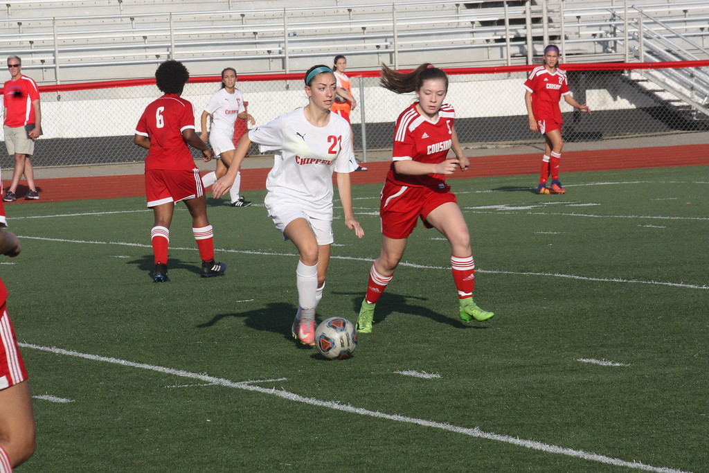 . Chippewa Valley\'s Mikaela Mandala looks to pass the ball while defended by Cousino\'s Mia Suratt during their MAC Blue Division match on May 14, 2018. (Photo gallery by Kevin Lozon)