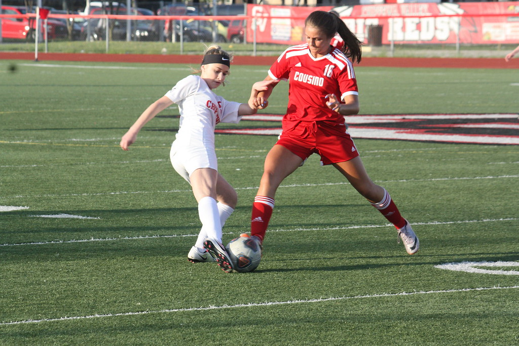. Chippewa Valley\'s Olivia Franz and Cousino\'s Julia Maraldo battle for possession of the ball during their MAC Blue Division match on May 14, 2018. (Photo gallery by Kevin Lozon)