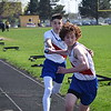 Cousino's Drew Demaris takes the baton from Arnes Besic during the 3200-meter relay. Cousino won the girls meet and Sterling Heights won the boys as the Warren Consolidated rivals met in MAC Blue Division track & field on April 18, 2017. (MIPrepZone photo gallery by George Pohly)
