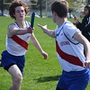 Cousino's Drew Demaris hands the baton to anchor runner Jack Koshko during the 3200 relay. Cousino won the girls meet and Sterling Heights won the boys as the Warren Consolidated rivals met in MAC Blue Division track & field on April 18, 2017. (MIPrepZone photo gallery by George Pohly)